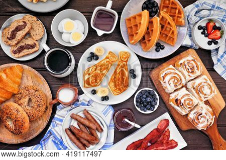 Fathers Day Brunch Table Scene. Above View On A Dark Wood Background. Tie Pancakes, Mustache Toast A