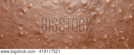 Milk Chocolate With Crushed Nuts Top View.the Texture Of Milk Chocolate With Crushed Nuts.
