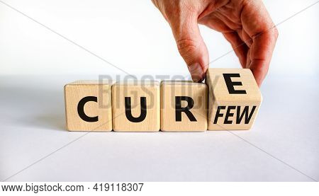 Curfew And Cure Symbol. Businessman Turns A Cube And Changes The Word 'curfew' To 'cure'. Beautiful