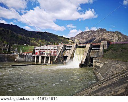 Olt River In Carpathian Mountains, Romania At Turnu Dam. European Route E81 In In Cozia Gorge Made B