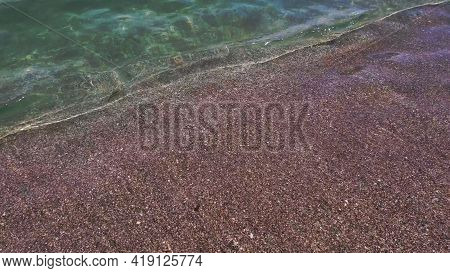 Clear Water Flowing To Shore On Beach Sand. Travel By Seaside. Transparent Blurry Water Waves Of Sea