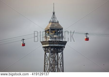 Barcelona, Spain - October 26, 2015: Cabins Leaving Torre Jaume I Of The Port Vell Aerial Tramway. I