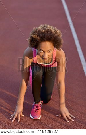 Sporty Little Girl Standing In Start Position Before The Sprint