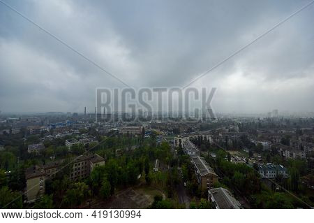 The Aerial View Of Urban Fringes In A Cloudy Day.view Over The City Rooftops At Industrial Suburb.he
