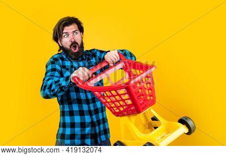 Shopaholic Concept. Good Discounts. Bearded Man In Checkered Shirt Carry Shopping Cart. Casual Guy F