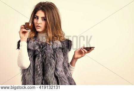 Woman Splendid Makeup Wearing Luxurious Fur Coat Drinking Hot Coffee. Pretty Lady Drink Coffee Littl