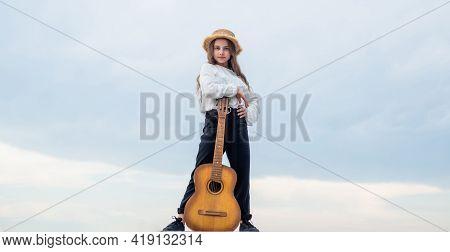 Trendy Looking Kid Girl Play Acoustic Guitar, Guitarist