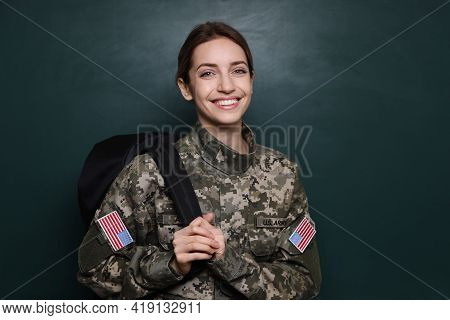Female Cadet With Backpack Near Chalkboard. Military Education