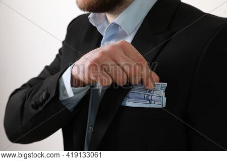 Man Taking Handkerchief From Suit Pocket On White Background, Closeup