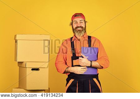 Bearded Loader In Uniform. Real Estate. Moving Day. Renovation Preparation. Unpacking Moving Boxes.