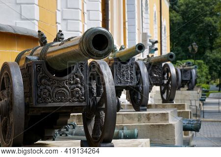 A Row Of Historic Cannons In The Vintage Artillery Exposition Outside The Arsenal In The Kremlin, Mo
