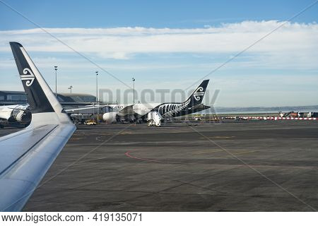 Auckland New Zealand - April 23 2021; Air New Zealand Planes At Auckland Airport Plane Wing And Tali