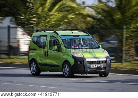 Alanya, Turkey - April 16 2021:  Green  Fiat Duplo  Is Driving Fast On The Street On A Warm Summer D