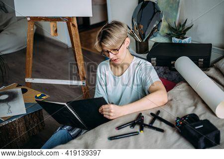 Woman Artist Drawing Sketch. Female Artist Creates A Sketch.