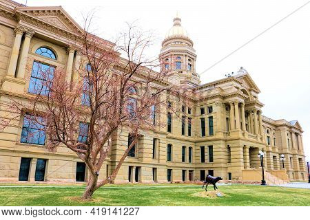 April 26, 2021 In Cheyenne, Wy:  Historical State Capital Building Surrounded By Grass And Trees Tak