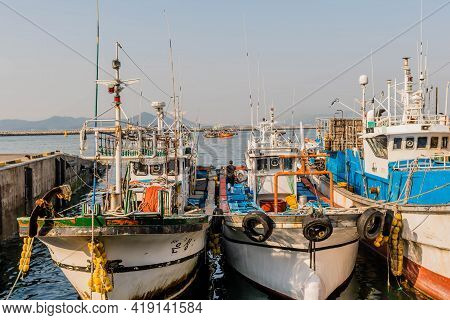 Daecheon, South Korea; April 25, 2021: Unidentified Man Walking On Deck Of Fishing Trawler Moored At