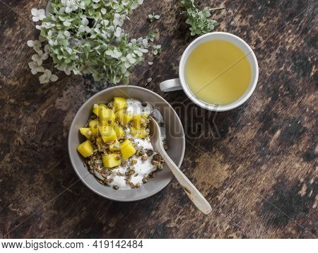 Ripe Mango, Granola Greek Yogurt And Green Tea - Delicious Breakfast, Brunch On A Wooden Background