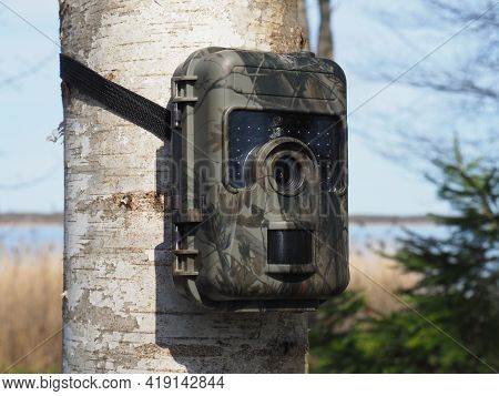 Outdoor Wildlife Surveillance Camera With Motion Detector. Hunting Trail Camera.