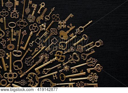 Vintage victorian style golden skeleton keys. Concepts of keys to success, unlocking potential, or achieving goals.