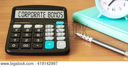 The Text Corporate Bonds Is Written On The Display Of The Calculator. Corporation Of Business Photo