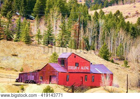 April 25, 2021 In Central City, Co:  Historical Mining Mill On An Alpine Meadow Surrounded By An Asp