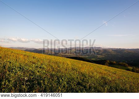 Green valley nature landscap. Mountain layers landscape. Springtime in mountain landscape. Meadow and mountains landscape. Blue mountains layers landscape. Beauty in nature. Landscape. Mountains. Valley nature.