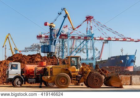 Container Terminal Of Tis Group Dry Cargo Port. Construction Truck And Volvo Heavy Bulldozer On Port