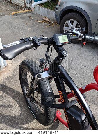 Honolulu - March 21, 2018: Rad Power Bikes Parked On Red Bike Rack.  A Seattle Ebike Company, Rad Po