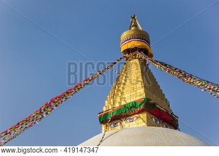 Golden Spire And Prayer Flags At The Boudhanath Stupa In Kathmandu, Nepal