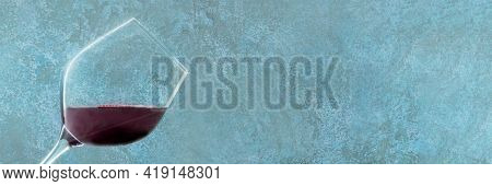Red Wine Panorama. A Wineglass On A Blue Background With A Place For Text