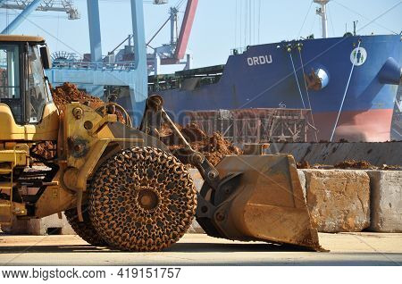 Construction Machine Excavator With Chained Wheel And Dirty Bulldozer Bucket. Heavy Bulldozer On Por