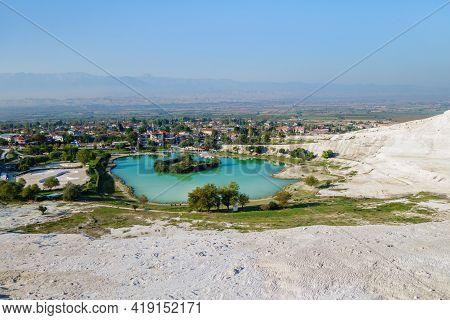 Panoramic View Onto Lake Near Foot Of Famous Travertines Of Pamukkale (turkey) & Town Itself. Bright