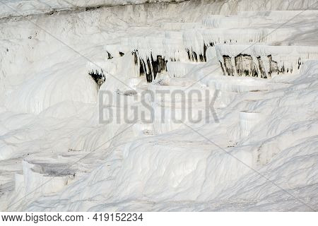 Travertine Terraces In Pamukkale, Turkey. Snow White Color Caused By Mineral Water From Hot Spring N