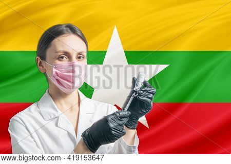 Girl Doctor Prepares Vaccination Against The Background Of The Myanmar Flag. Vaccination Concept Mya