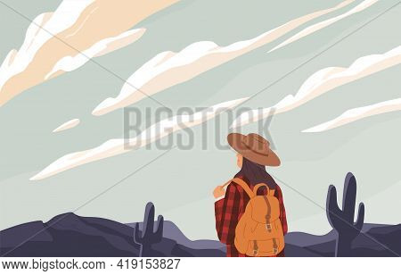 Woman With Backpack Looking Into Distance, Enjoying Serene Desert Landscape And Sky With Clouds. Rel