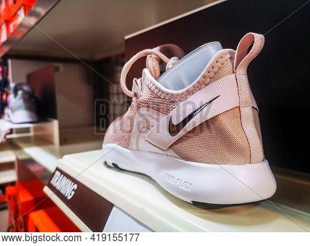 Women's Sneakers Nike Flex With Soft Soles In The Store 01.05.2021 Russia, Kazan, Khusain Yamasheva