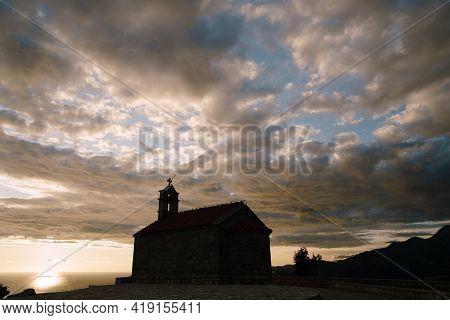 Church Sveti Savva Near Island Sveti Stefan At The Sunset Time