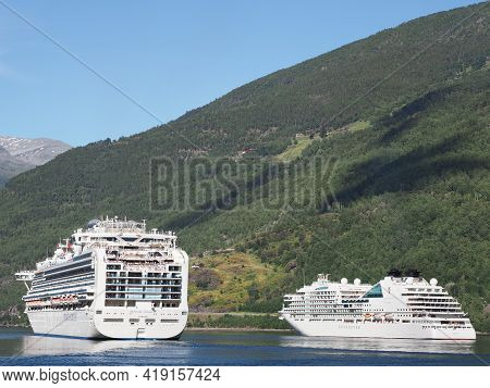 Flam, Norway On July 2019: Two White Liner Cruises In Sogn Og Fjordane Region With Clear Blue Sky In