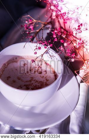 White Cup Of Milk And Chocolate. Morning Aesthetics Vibes. Breakfast. Pink Gypsophila Flowers