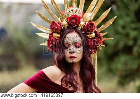 Young Woman With Painted Skull On Her Face For Mexico's Day Of The Dead.