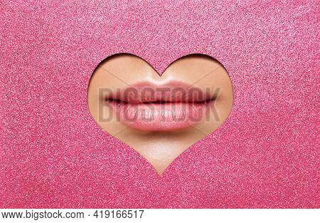 Beauty Lips Makeup Close Up. Natural Plump Bright Lip Glossy Lipstick Look Through Heart Shaped Hole