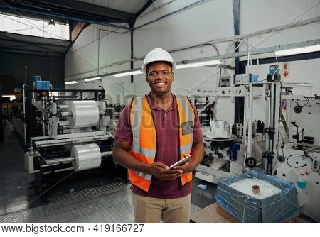 Happy African Supervisor Standing In Warehouse Holding Digital Tablet In Hand