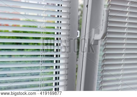 Fragment Of The Modern Tilt And Turn Plastic Window Tilted Inwards At The Top With Control Handle An