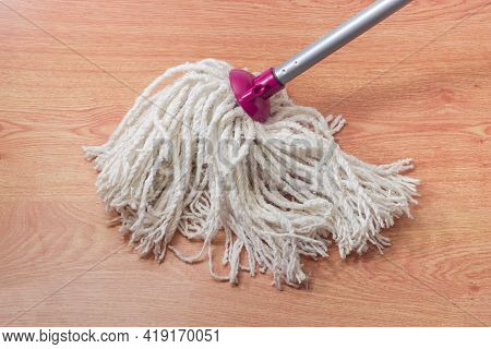 Bottom Working Part Of Classic Yarn Mop In The Form Of Bundle Of Cotton Rope Segments On A Wooden Fl