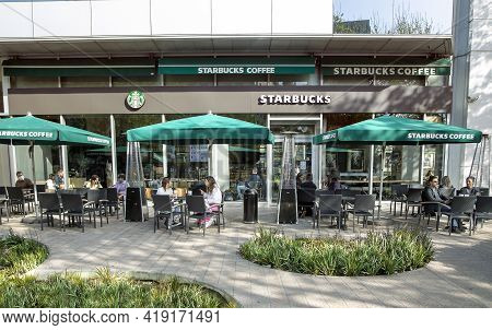 Spain, Barcelona, March, 2021: People Drink Coffee And Communicate Live On The Open Veranda Of The S