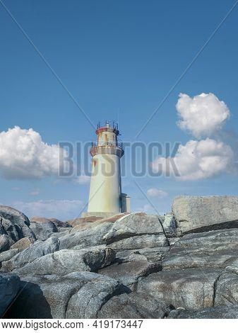 Rusty Metal Lighthouse On Rocks In Galicia, Spain