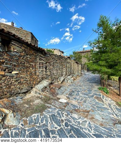 Cobbled Street With Stone House. Patrones De Arriba In Spain