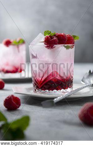 Summer Fresh Beverage Cocktail With Fresh Raspberries And Fresh Mint Leaf