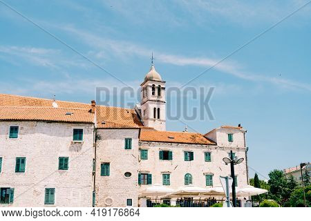 Franciscan Monastery Sveti Frane, Sibenik, Dalmatia, Croatia On The Background Of Blue Sky And Green