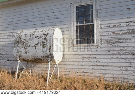 A Fuel Tank For Heating A Building With Are Both Displaying Peeling Paint And Neglect